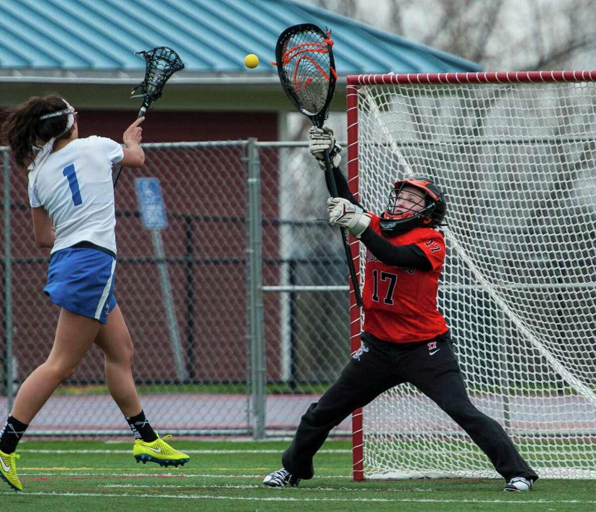 Ridgefield High School goalie Maddie Burns, right, made 395 saves in her career.