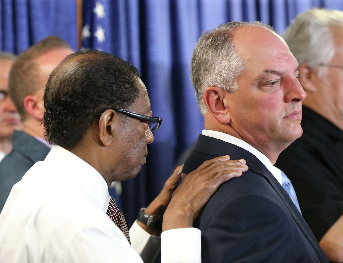 Baton Rouge Mayor Kip Holden, left, and Louisiana Gov. John Bel Edwards, right, listen during a news conference Monday, July 18, 2016, in Baton Rouge, La. In a city already tense after the high-profile police shooting, multiple Baton Rouge police officers were killed and others wounded on Sunday. State police say the fatal shooting of the enforcement officers in was an ambush by a former Marine who