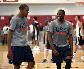 LAS VEGAS, NV - JULY 18:  Kevin Durant (L) #5 and Draymond Green #4 of the 2016 USA Basketball Men's National Team talk during a practice session at the Mendenhall Center on July 18, 2016 in Las Vegas, Nevada.  (Photo by Ethan Miller/Getty Images)