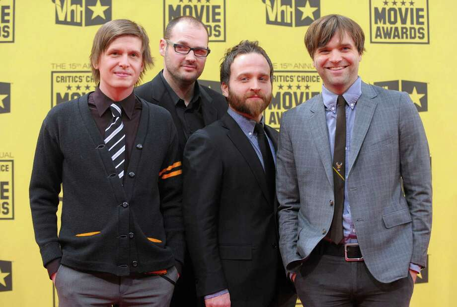 HOLLYWOOD - JANUARY 15:  (L-R) Musicians Jason McGerr, Chris Walla, Nick Harmer, and Ben Gibbard of the band Death Cab For Cutie arrive at the 15th annual Critics' Choice Movie Awards held at the Hollywood Palladium on January 15, 2010 in Hollywood, California.  (Photo by Jason Merritt/Getty Images for VH1) Photo: Jason Merritt / 2010 Getty Images