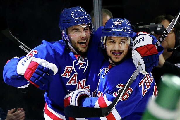 NEW YORK, NY - MAY 11:  Derick Brassard #16 celebrates his goal with Mats Zuccarello #36 of the New York Rangers in the second period against the Pittsburgh Penguins during Game Six of the Second Round of the 2014 NHL Stanley Cup Playoffs at Madison Square Garden on May 11, 2014 in New York City.  (Photo by Elsa/Getty Images) ORG XMIT: 488087755