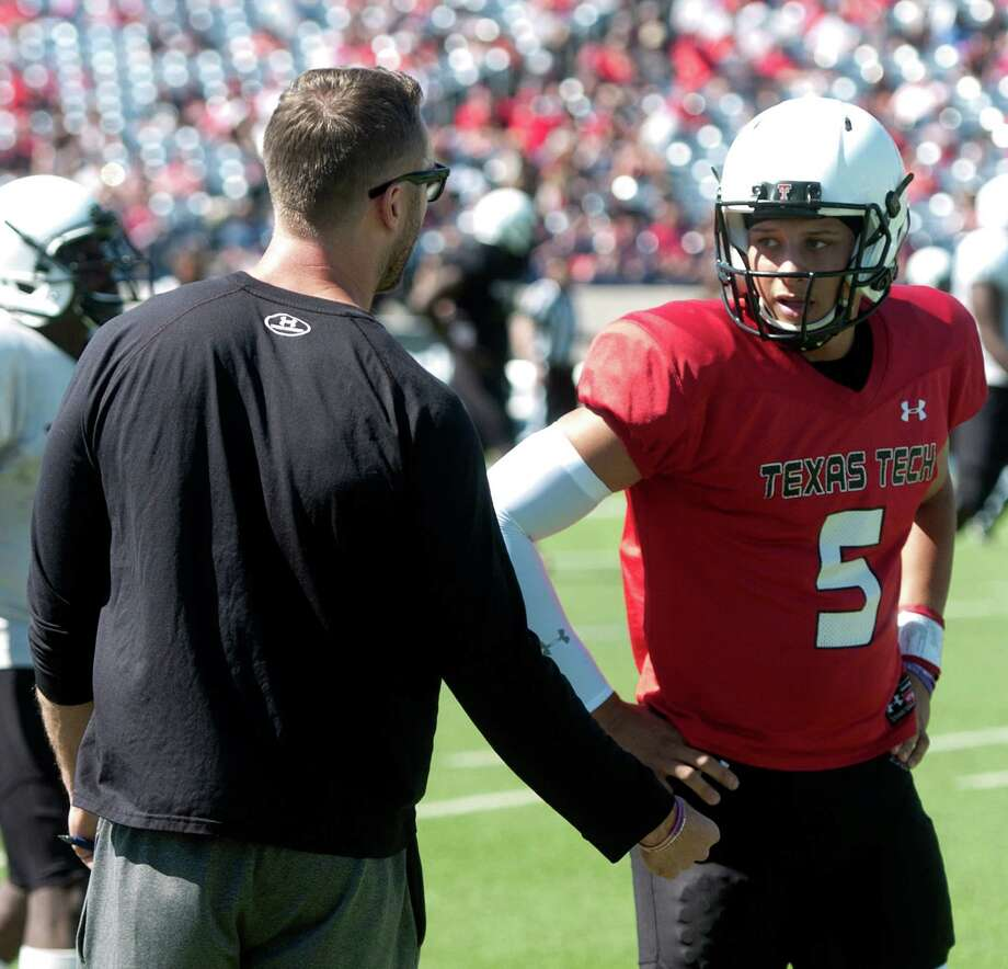 Tech coach Kliff Kingsbury, left, looks forward to seeing former dual sport ath-lete Patrick Mahomes apply what he learned in an offseason devoted to football. Photo: James Durbin / © 2014 Midland Reporter Telegram. All Rights Reserved.