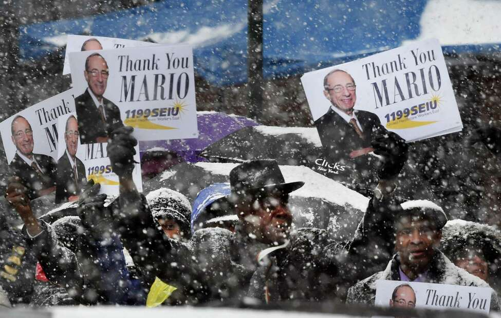 Members of 1199 SEIU show their gratitude at funeral of former Governor Mario M. Cuomo on Tuesday morning, Jan. 6, 2015, at St. Ignatius Loyola Church in New York. (Skip Dickstein/Times Union archive)