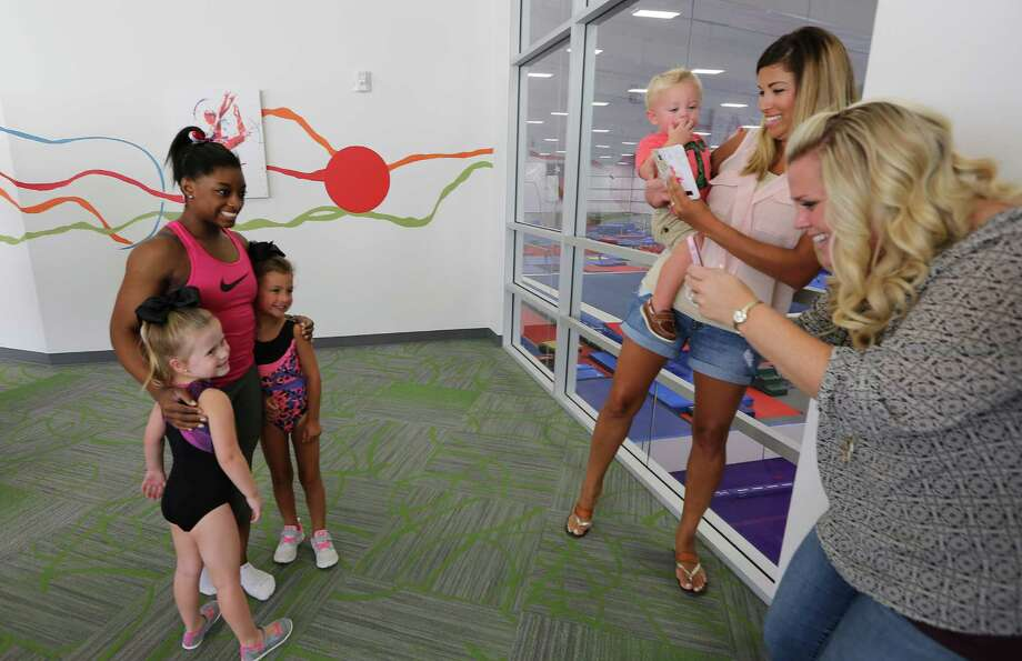 These two girls can say they had their special moment with Simone Biles and might aspire to compete in the Olympics, also. Photo: Steve Gonzales / © 2016 Houston Chronicle