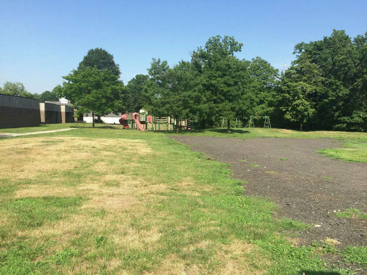 This is the property of Center School in Stratford, Connecticut, on July 18, 2016. The school was decommissioned in 2005, but the Town Council wants to reopen it as a school. Mayor John Harkins disagrees, saying that he would like to develop it with a parking garage, apartments, shops and so forth.