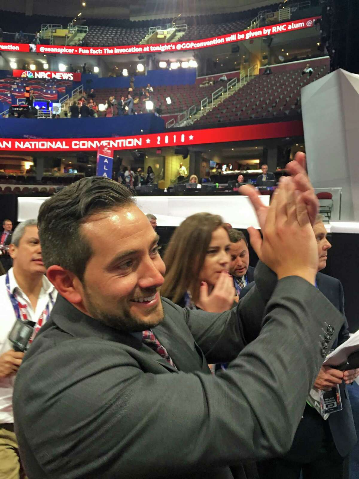 State GOP Chairman J.R. Romano applauds as former Texas Gov. Rick Perry addresses delegates at the Republican National Convention in Cleveland on Monday, July 18, 2016.