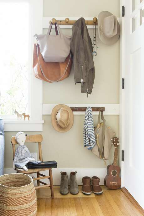 Shira Gill relies on wall-mounted hooks and pegs to keep her home tidy. Photo: Vivian Johnson