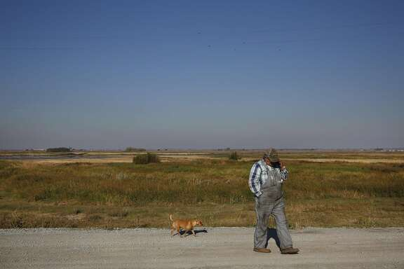 Jaime Barajas, 59, pictured with his dog Peanut on Webb Tract Island, an Island he manages that farms corn Nov. 13, 2015 near Rio Vista, Calif. Webb Tract Island is one of two Islands that Barajas manages for a local farmer. Barajas lives on Bouldin Island.