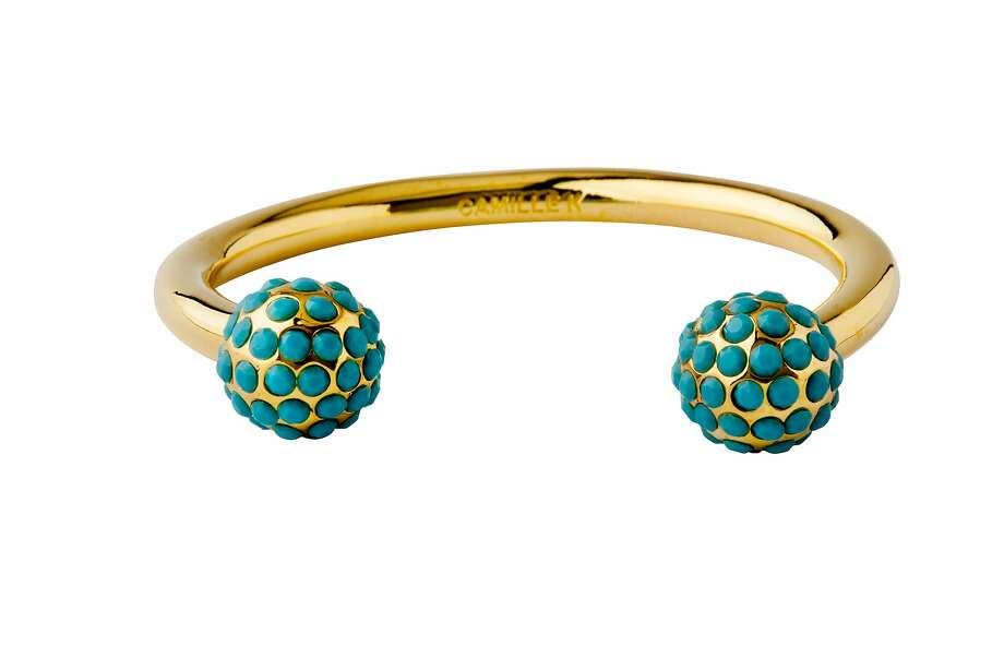 This sleek golden cuff, the Signature pave perle cuff by Burlingame jewelry line Camille K, features turquoise Swarovski crystals and is priced at $385. Available at www.camillek.com Photo: Camille K