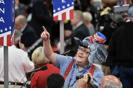 A delegate gestures on the first day of the Republican National Convention on July 18, 2016 at the Quicken Loans Arena in Cleveland, Ohio. The Republican Party opened its national convention Monday, kicking off a four-day political jamboree that will anoint billionaire Donald Trump as its presidential nominee. Some 2,000 delegates descended on a tightly secured Cleveland arena where Trump's wife will take center stage later in the day to make a personal pitch to voters that her billionaire husband is the best candidate for the White House. / AFP PHOTO / Andrew CABALLERO-REYNOLDSANDREW CABALLERO-REYNOLDS/AFP/Getty Images