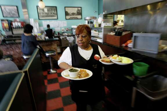Waitress Cassie Lemon carries lunch orders at the Avalon Diner, 2417 Westheimer, Wednesday, July 13, 2016, in Houston. She is retiring after 50 years at the Avalon Diner.