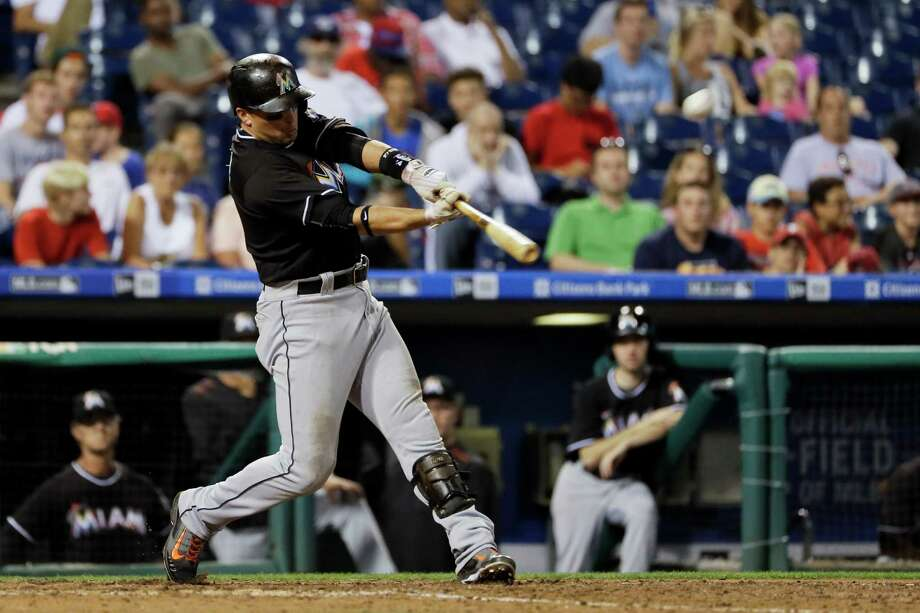 Miami Marlins' Martin Prado hits the go-ahead home run off Philadelphia Phillies relief pitcher Brett Oberholtzer during the 11th inning of a baseball game, Monday, July 18, 2016, in Philadelphia. Miami won 3-2 in 11 innings. (AP Photo/Matt Slocum) ORG XMIT: PXS106 Photo: Matt Slocum / Copyright 2016 The Associated Press. All rights reserved. This m