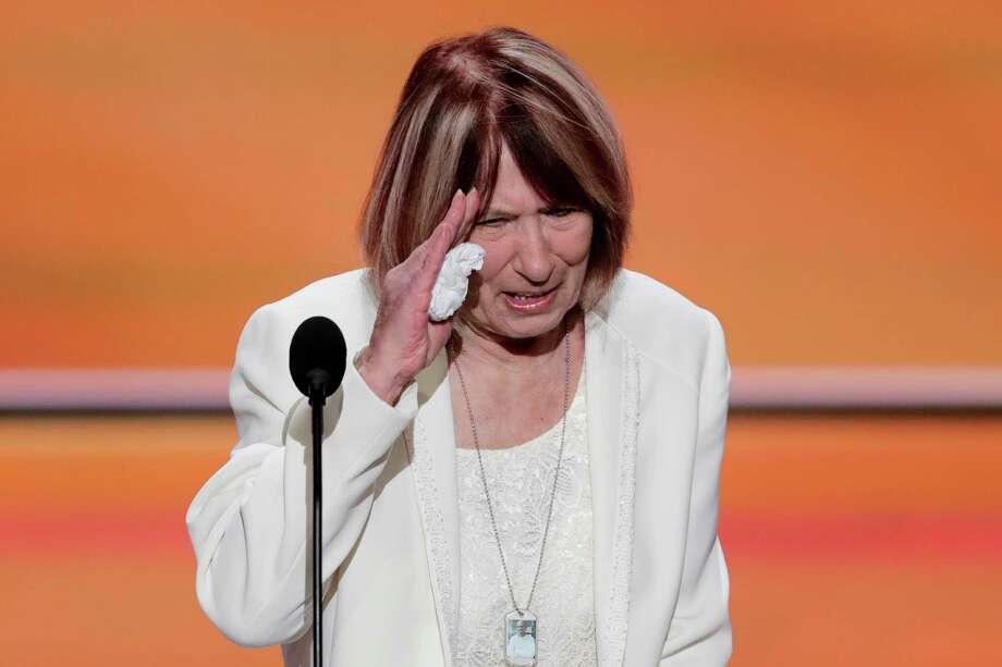 Pat Smith, mother of Benghazi victim Sean Smith, salutes after speaking during the opening day of the Republican National Convention in Cleveland, Monday, July 18, 2016. Smith blamed Clinton for her son's death in Benghazi during her speech. Mary F. Commanday, mother of another Benghazi victim, asked that Trump and other Republicans leave her son out of their politics. Photo: J. Scott Applewhite / Copyright 2016 The Associated Press. All rights reserved. This m