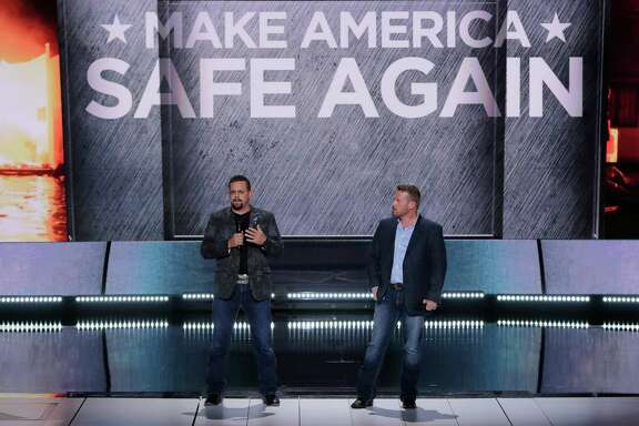 John Tiegen, a U.S. Marine Corp veteran and Mark Geist, a U.S. Marine Corps veteran who fought in Benghazi, L-R, speak during the opening day of the Republican National Convention in Cleveland, Monday, July 18, 2016. (AP Photo/J. Scott Applewhite) ORG XMIT: RNC152