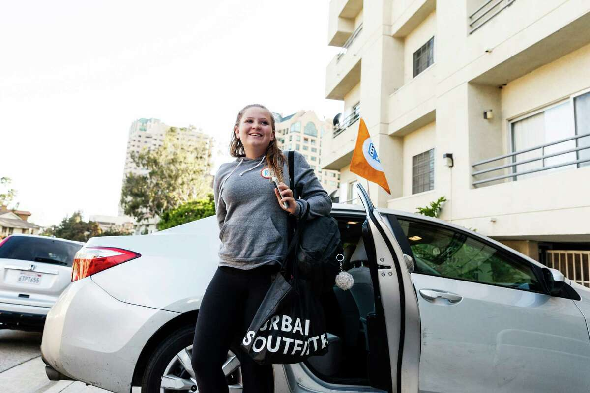 Emma Aluise, 12, arrives home after taking a HopSkipDrive ride from swim practice, in Los Angeles, April 11, 2016. (Emily Berl/The New York Times)