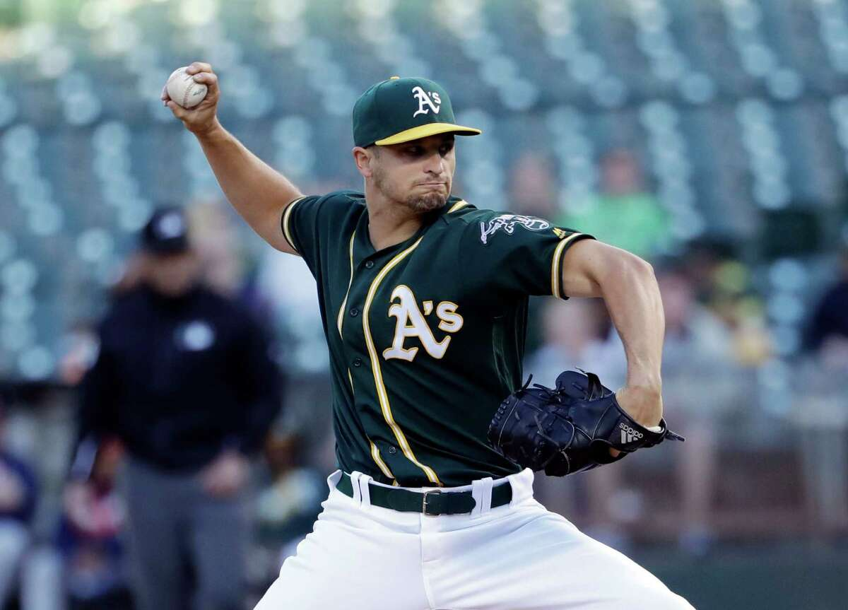 Oakland Athletics starting pitcher Kendall Graveman throws to the Houston Astros during the second inning of a baseball game Monday, July 18, 2016, in Oakland, Calif. (AP Photo/Marcio Jose Sanchez)
