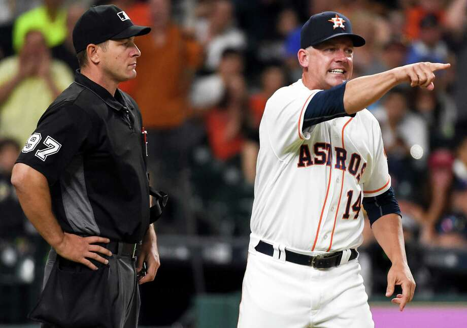 Houston Astros manager A.J. Hinch (14) argues with home plate umpire Ben May after May called out Carlos Correa on strikes in the eighth inning of a baseball game against the Seattle Mariners, Saturday, May 7, 2016, in Houston. (AP Photo/Eric Christian Smith) Photo: Eric Christian Smith, FRE / FR171023 AP
