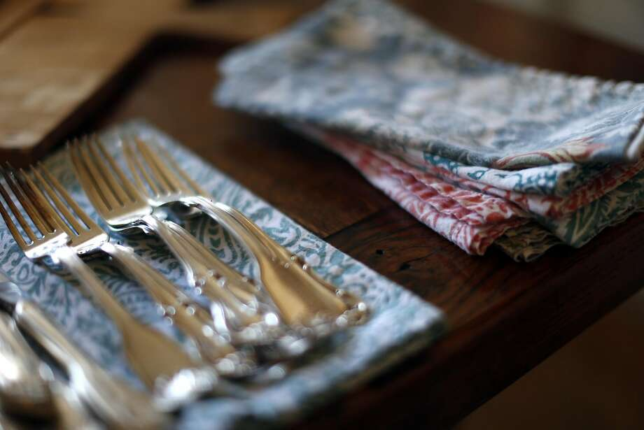 """Cloth napkins and silverware add an air of formality to """"The Way Out of Black Holes"""" with string theorist Andy Strominger, a party at Susan Mactavish Best's Pacific Heights home on Monday, July 18, 2016. Photo: Scott Strazzante, The Chronicle"""