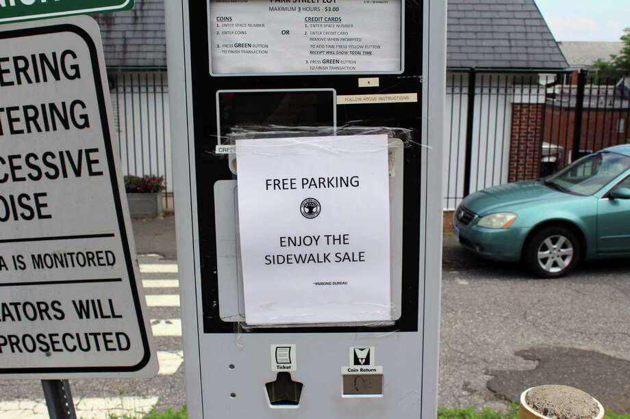 The New Canaan Parking Commission offered free parking for shoppers during the New Canaan Sidewalk Sale on July 15, 2016. Photo: Justin Papp / Hearst Connecticut Media / New Canaan News