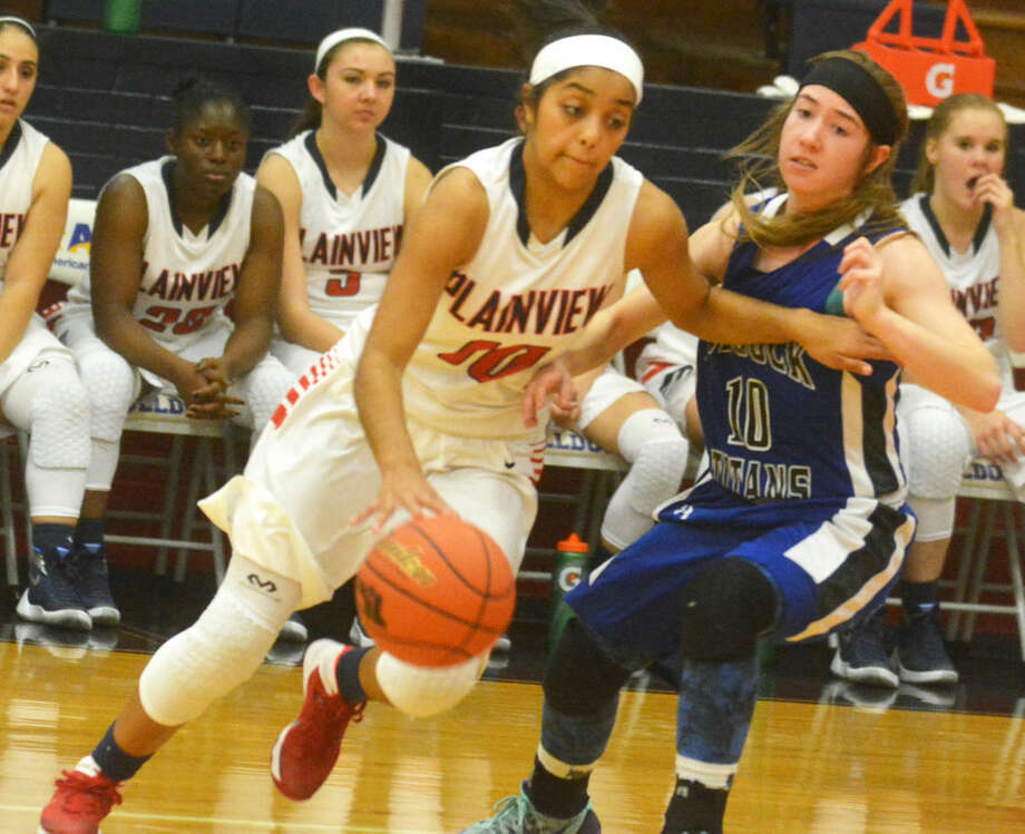 Plainview's Brittany Rincon (left) drives against an opponent during a game earlier this season. The senior scored 14 points to help the Lady Bulldogs to a 41-39 win at Bushland. Photo: Skip Leon/Plainview Herald