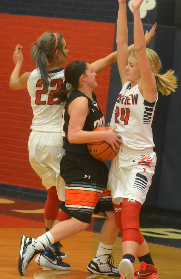 Plainview's Allie Bennett (24) stops a Dumas player on a drive to the basket as Harlee Davis (22) also defends during the teams' first meeting of the season. The Lady Bulldogs lost at Dumas Saturday in the rematch. Photo: Skip Leon/Plainview Herald