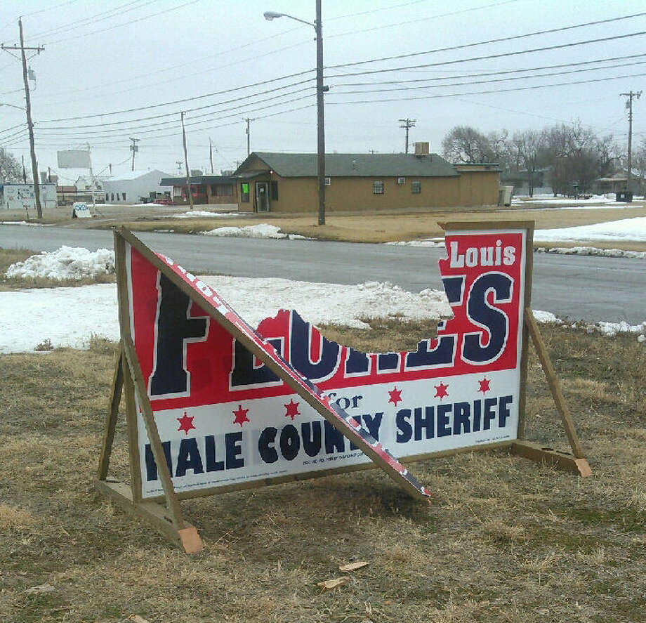 A large campaign sign supporting Luis Flores for sheriff was damaged hours after it was place Tuesday afternoon at 24th and Frenso. It has since been replaced.