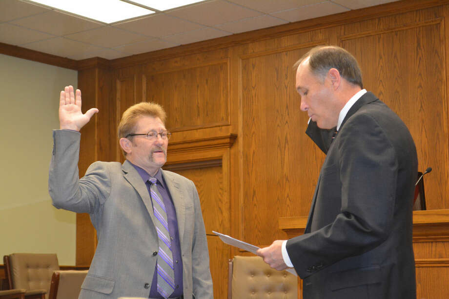 County JudgeDoug McDonough/Plainview HeraldCounty Judge Bill Coleman is administered his oath of office by District Judge Rob Kinkaid during a New Year's Day ceremony on Thursday at the Hale County Courthouse. Coleman was re-elected in November.