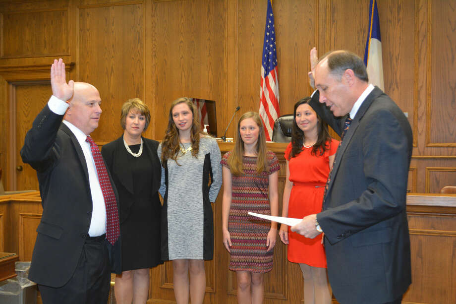 HERE COMES THE JUDGEDoug McDonough/Plainview HeraldNew 242nd State District Court Judge Kregg Hukill (left) receives his oath of office from 64th District Court Judge Rob Kinkaid his Hukill's wife, Lezlie, and daughters Claire, Lauren and Kaitlin look on. The new judge, who replaces retiring Judge Ed Self, was sworn in at 9 a.m. Thursday in a New Year's Day ceremony in the Hale County Courthouse.