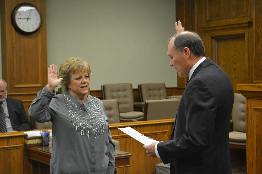 District ClerkDoug McDonough/Plainview HeraldDistrict Clerk Carla Cannon receives her oath of office on Thursday from District Judge Rob Kinkaid after she was re-elected in the November general election.