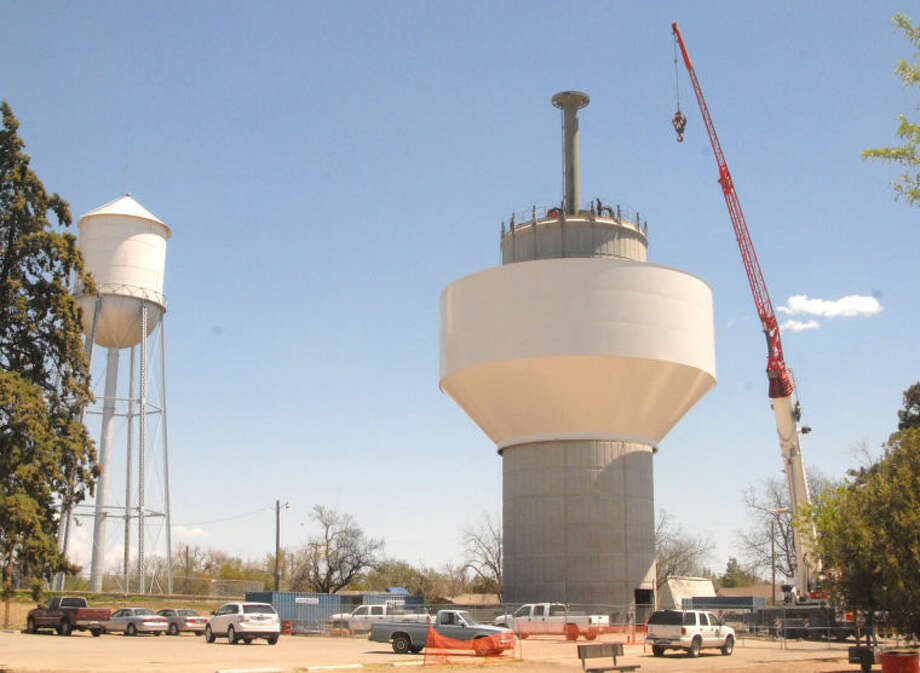 Tank lifted into place at new water tower adjacent to Hale County Senior Citizens Center.