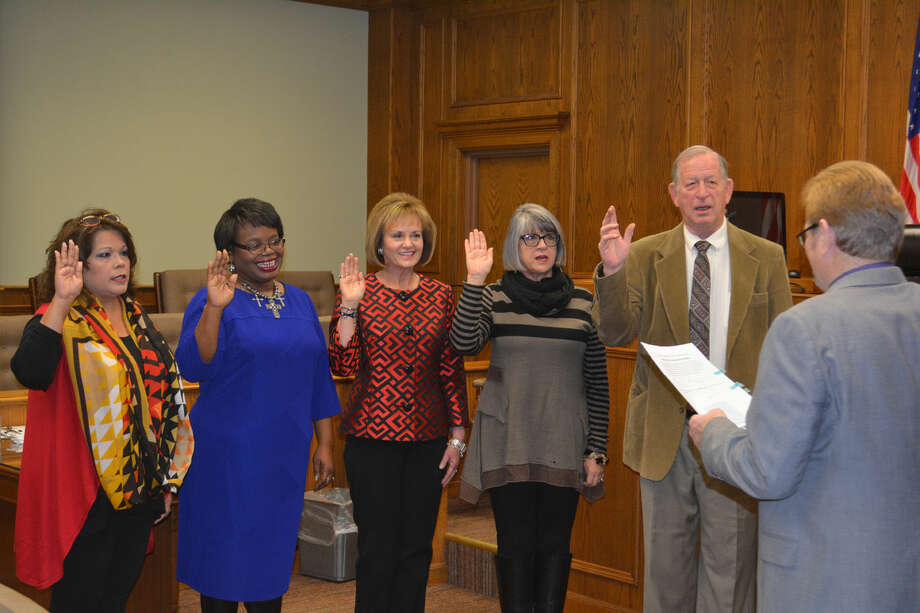 OATH OF OFFICEDoug McDonough/Plainview HeraldAmong the county officials taking their oaths of office in a New Year's Day ceremony on Thursday morning following elections in November are County Treasurer Ida Tyler (left), Justice of the Peace Precinct 1 Sheron Collins, Justice of the Peace Precinct 3 Karen Davis, County Clerk Latrice Kemp and County Surveyor Carl Joe Williams. County Judge Bill Coleman administered the oath. With the exception of Collins who replaced retiring Judge Kaye Phillips, all were re-elected to their posts.