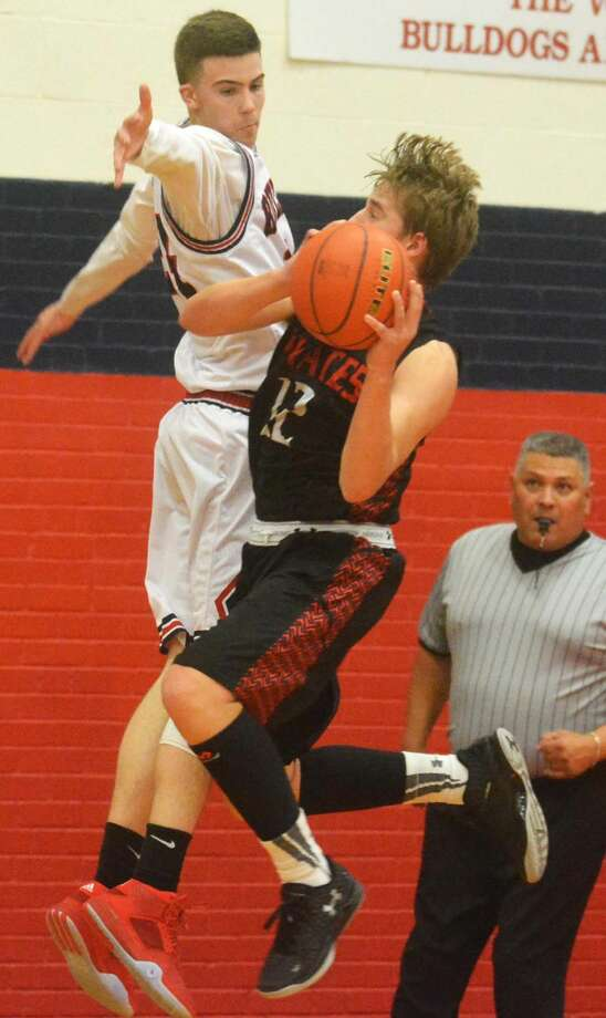 Plainview's Bryson DeBerry (left) defends against Lubbock Cooper's Reagan Schulte (12) during the opening District 4-5A game at the Dog House Friday night. DeBerry scored 10 points to help Plainview to a 50-32 victory. Photo: Skip Leon/Plainview Herald