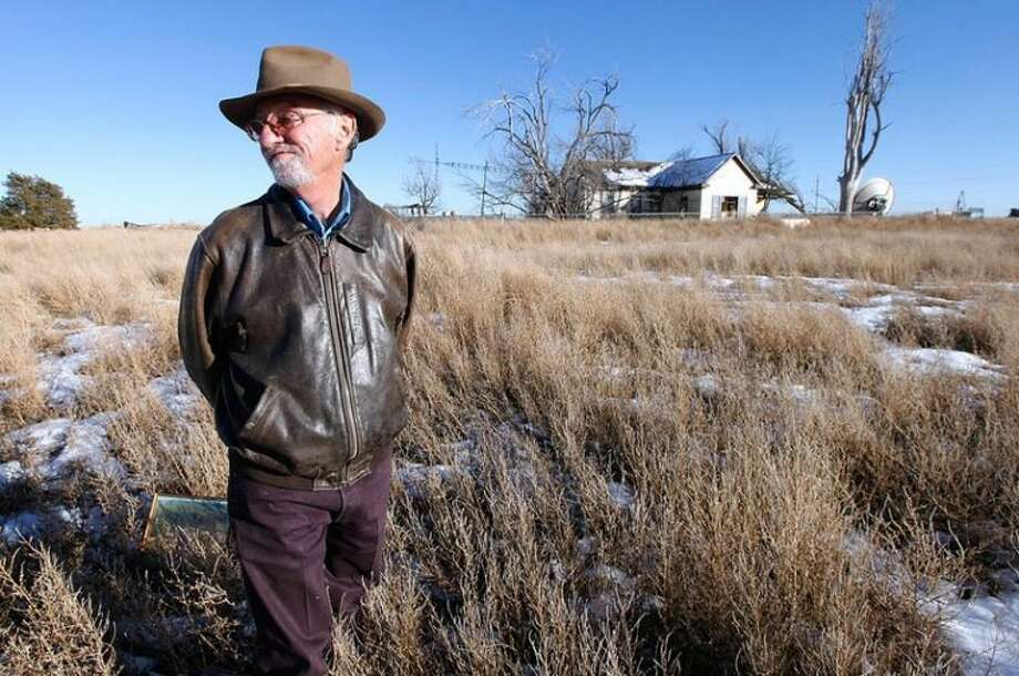 Stephen Spillman/Texas TribuneMike Skinner on Dec. 26, 2013, outside the farmhouse on the land five miles east of Spearman that he sold last spring. Three generations of his family had farmed the land.
