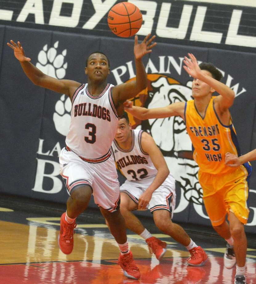 Plainview's Ben McGee (3) beats a Frenship player to a loose ball and starts a fast break during a game Tuesday. The Bulldogs open district play Friday night at home against Lubbock Cooper. Photo: Skip Leon/Plainview Herald