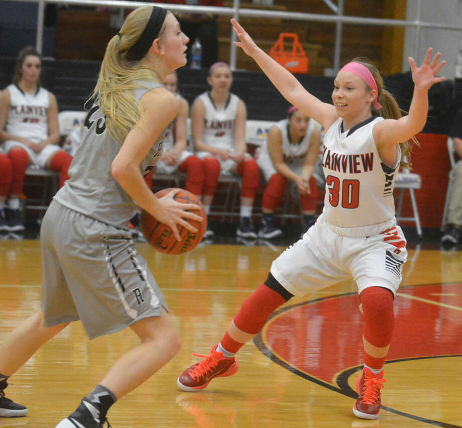Plainview's Jaden Gonzales (30) plays defense in a game earlier this season. Gonzales, a senior guard, scored 21 points to help the Lady Bulldogs to a 50-46 win at Abilene Cooper Tuesday night in their opening District 4-5A game. Photo: Skip Leon/Plainview Herald