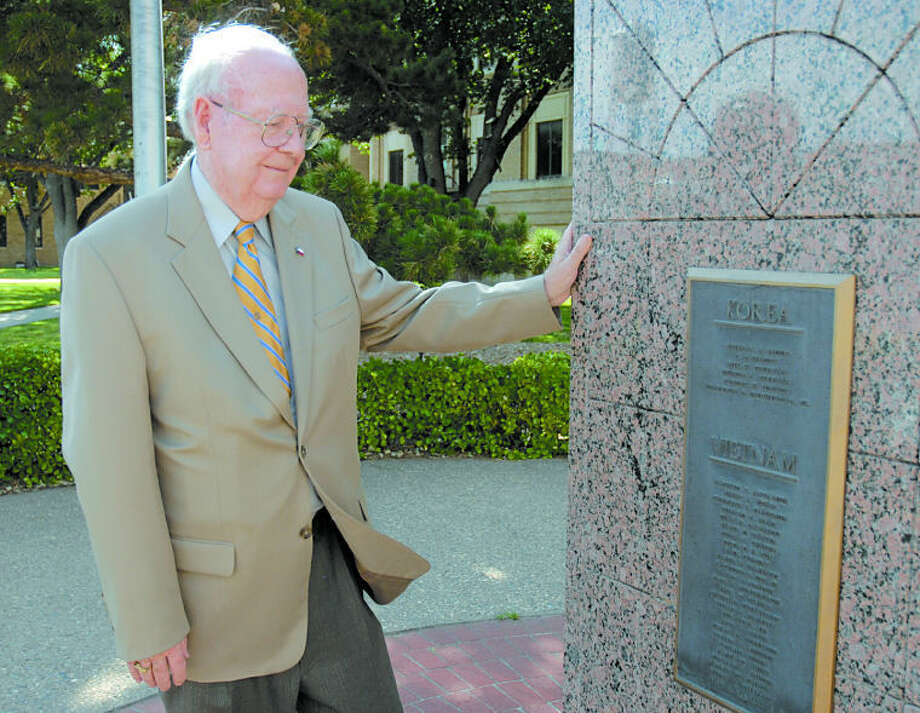 "The late Judge William (Bill) Hollars stands at the veterans memorial on the courthouse square, a milestone the lifelong ""yellow dog Democrat"" was most pleased with during his 46 years in state and local politics. Photo: Richard Porter/Plainview Herald"