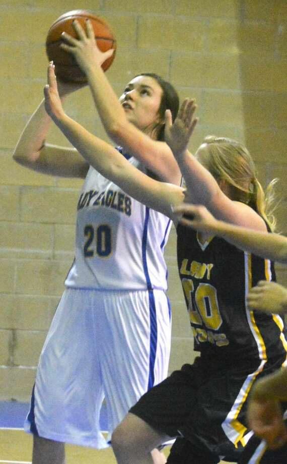 Plainview Christian Academy's Abbey Maresca goes up for a shot against Kress in a game earlier this season. The Lady Eagles opened district play at home Tuesday with a 43-41 victory over Lubbock Christ the King. Photo: Skip Leon/Plainview HErald