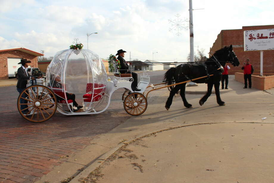 Juan and Pauline Garza ride in style in a carriage pulled by a prancing black horse. Son Gary Garza built the carriage. After renewing their vows for their Golden Wedding Anniversary at Sacred Heart Catholic Church, they rode in the carriage more than two dozen city blocks to JP Ballroom.