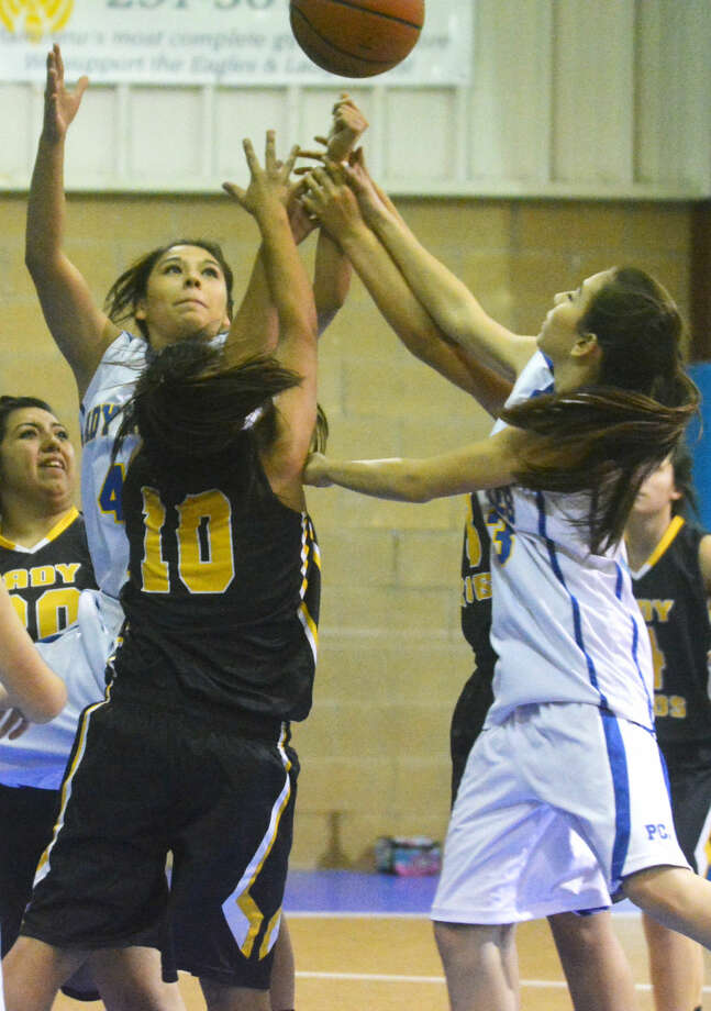 Plainview Christian Academy's Savannah Guzman (back) and Andrea Lara (right) vie for a rebound during a game earlier this season. Guzman scored seven points Friday night and Lara filled in at point guard as the Lady Eagles beat Amarillo Ascension to improve to 2-0 in district play. Photo: Skip Leon/Plainview Herald