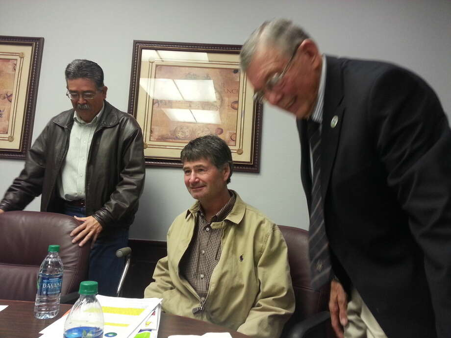 Charles Starnes/Courtesy Photo District 7 City Councilmember Eric Hastey returned to his seat for the first time Tuesday since a serous work accident. Mayor Wendell Dunlap and Council Member Lionel Garcia greet him.