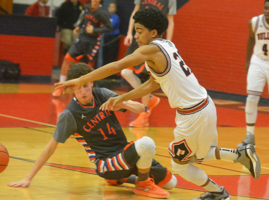 Plainview's Braxton Riddley (right) runs past San Angelo Central's Cody Henson (14) to get to a loose ball during a game at the Dog House Friday night. Riddley swished a three-point shot at the final buzzer to give the Bulldogs a 71-70 victory. Photo: Skip Leon/Plainview Herald
