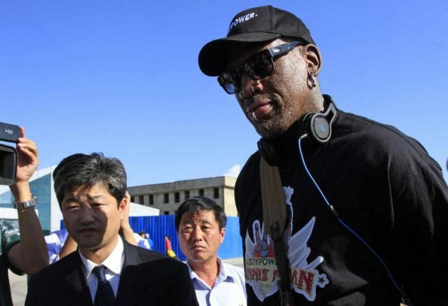Associated Press Former NBA star Dennis Rodman arrives Tuesday at Pyongyang airport in North Korea.