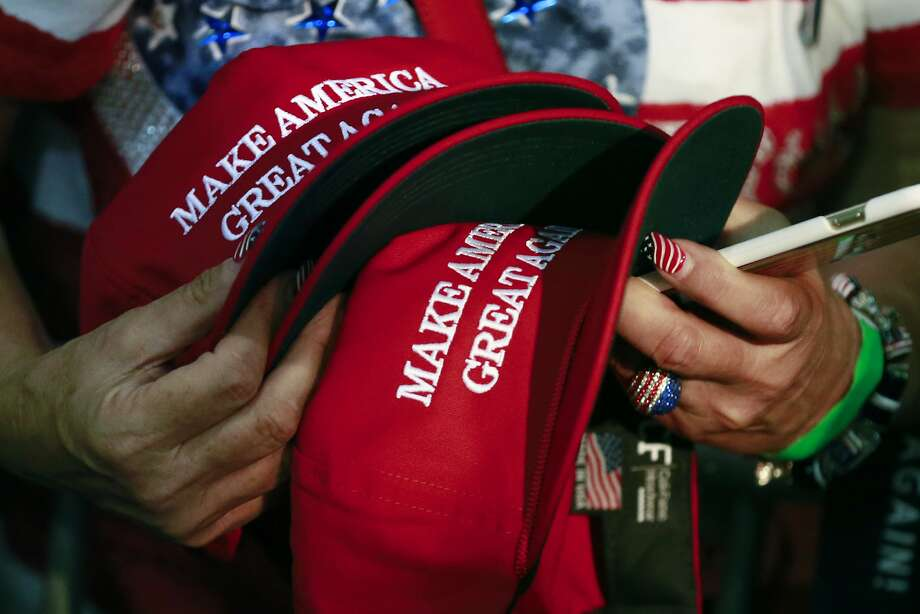 In this June 2, 2016, file photo, a woman holds hats to get them autographed by then-presidential candidate Donald Trump during a rally in San Jose. Photo: Jae C. Hong, Associated Press