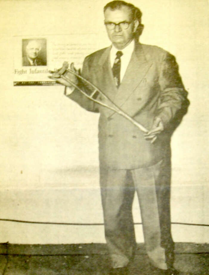 Herald File PhotoPlainview resident Wilmer Mauldin learned to walk with a pair of small crutches at age 3, about two years after he was stricken and partially paralyzed by polio. Members of his family fashioned a pair of crutches by hand and spent hours massaging his weakened muscles.