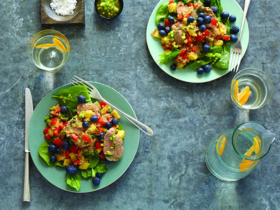 This salad combines quinoa, spinach, pork, squash and berries for a filling and healthy meal. Photo: Miki Duisterhof