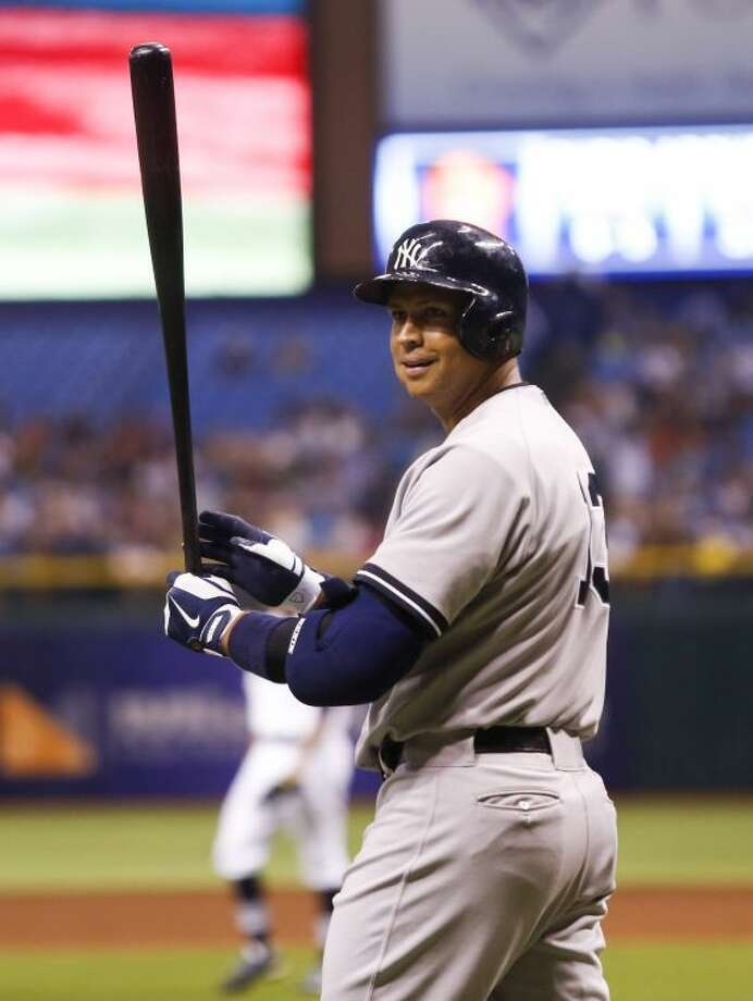 New York Yankees third baseman Alex's Rodriguez had his suspension reduced by an arbitrator Saturday, but the veteran will still miss the entire 2014 season for using performance-enhancing drugs. Photo: Will Vragovic/Tampa Bay Times/MCT