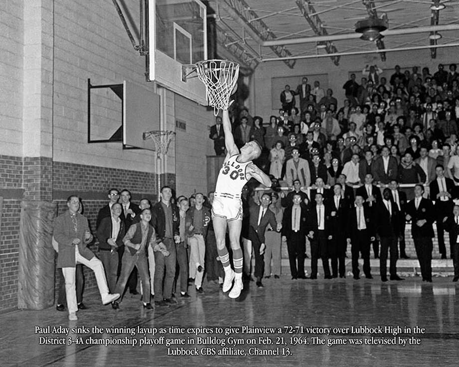 This blown-up photo of Paul Aday making the winning layup in a basketball game nearly 50 years ago will be presented to Plainview High School Tuesday night. Photo: Courtesy Photo