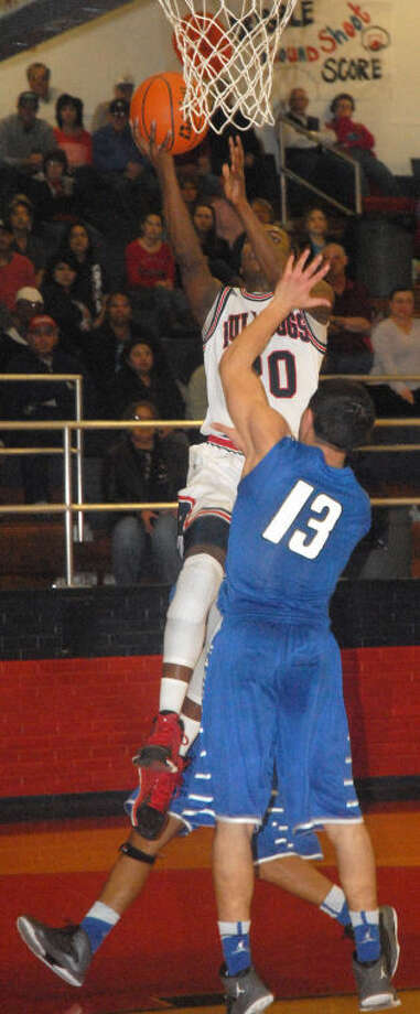 Plainview's Ben McGee (20) goes in for two of his game-high 17 points in the opening District 4-4A game of the season against San Angelo Lake View at the Dog House Friday night. Photo: Skip Leon/Plainview Herald