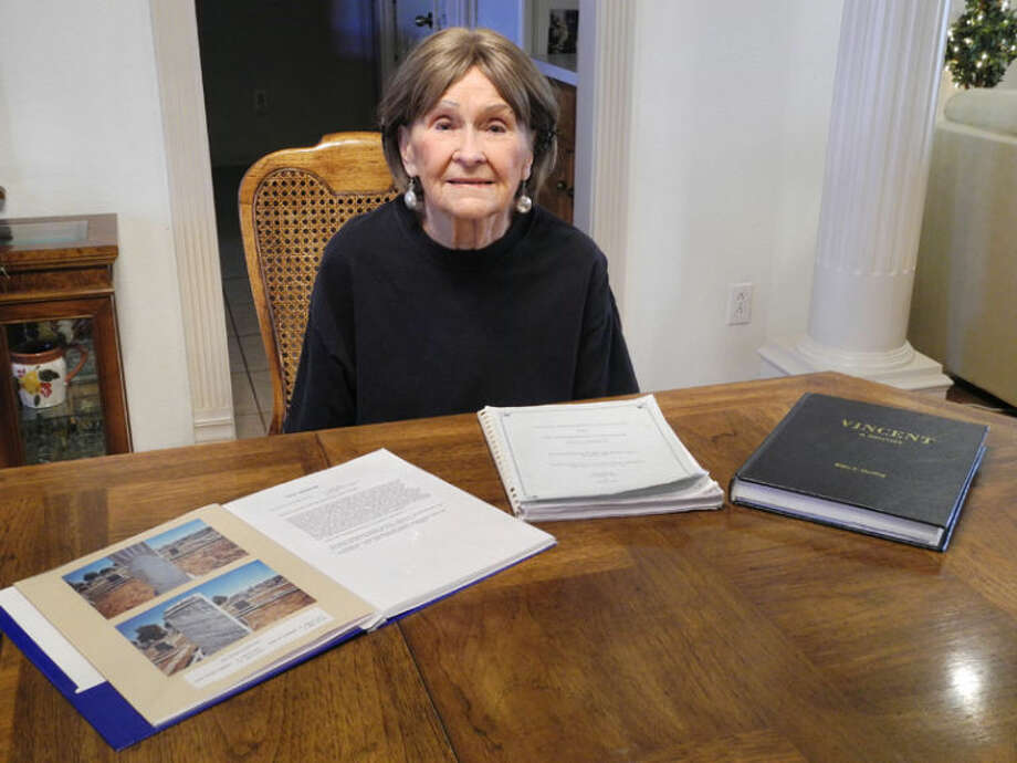 Patty Winters searches through books and documents to trace the history of her ancestors, CDC Eiland in particular. His whereabouts from 1900 till his death in 1917 are unknown. Photo: Gail M. Williams | Plainview Herald