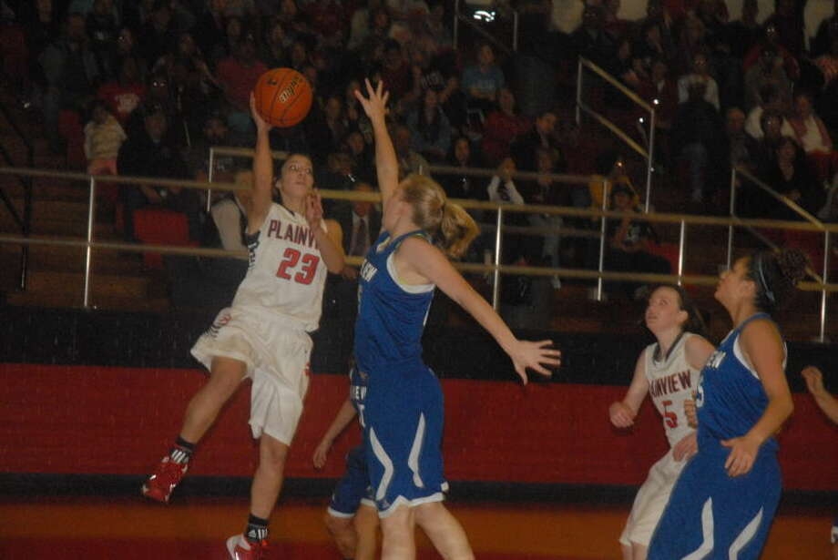 Plainview's Karli Wheeler drives to the basket for two of her team-high nine points against San Angelo Lake View Friday night. The Lady Bulldogs are ranked No. 18 in the Texas Association of Basketball Coaches (TABC) Class 4A poll this week. That's four places higher than they were ranked last week. Photo: Skip Leon/Plainview Herald